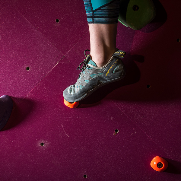 rock climbers foot stepping up